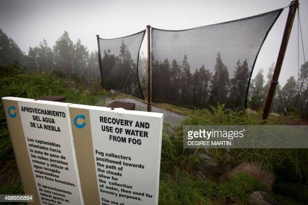 A picture taken on November 23 2015 shows Chilean type fog collectors on the Spanish canary island of Tenerife The fog collection uses large canvas...