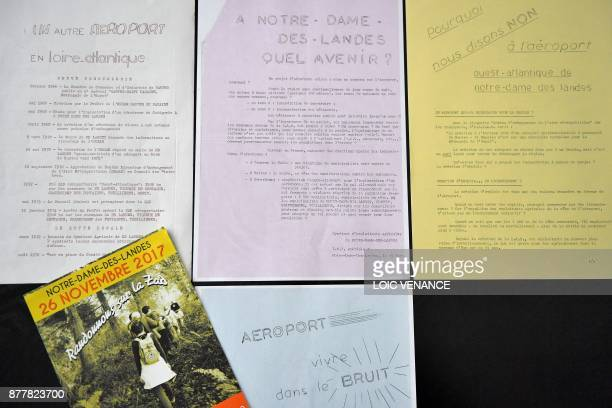A picture taken on November 23 2017 in Nantes western France shows a combo of 1974 and 2017 leaflets against NotreDamedesLandes airport a few days...