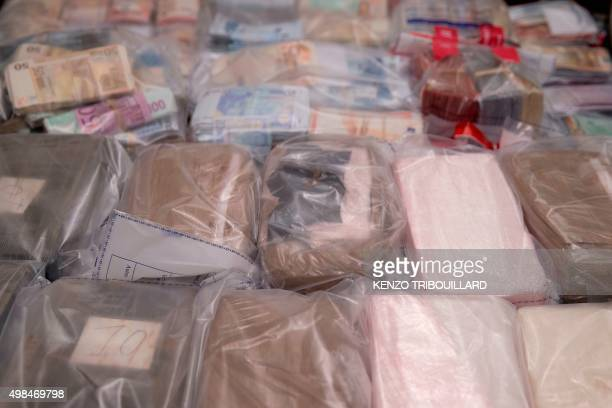 A picture taken on November 23 at the headquarters of the French Judicial Police shows a part of the 18kg of cocaine 20 kg of cannabis 300000 euros...