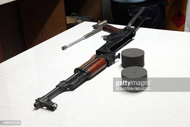 A picture taken on November 24 2015 shows an AK47 assault rifle examined by French gendarmes from UNPOL in the Minusma headquarters in Bamako Riffles...
