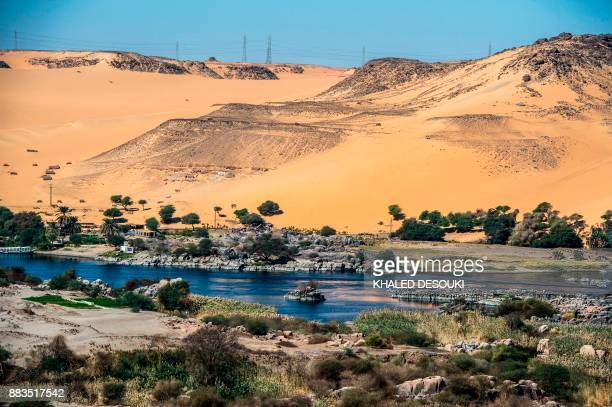 A picture taken on November 24 2017 shows the Nile river as it flows through the Egyptian city of Aswan some 920 kilometres south of the capital...