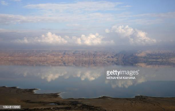 A picture taken on November 24 2018 shows part of the Dead Sea backdropped by mountains in Jordan as seen from the Judean Desert in the West Bank