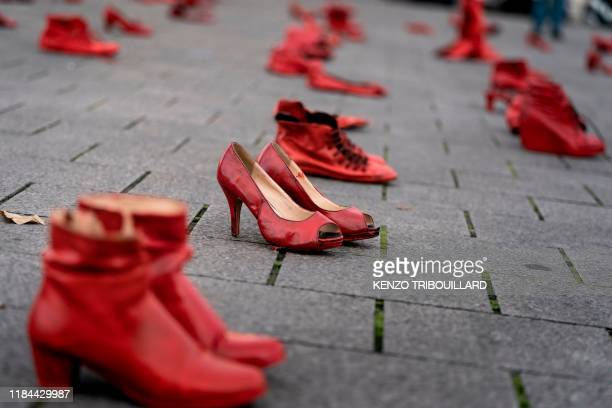 Picture taken on November 24 in Brussels shows red shoes set up on the ground for the victims during a protest to condemn violence against women.