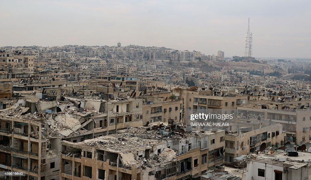 A picture taken on November 24, 2014, shows damaged buildings in the rebel-held Ansari disctrict of the northern Syrian city of Aleppo. Syria's war began as a peaceful revolt, but later morphed into a Sunni-dominated insurgency after President Bashar al-Assad's regime launched a massive crackdown on dissent.