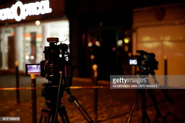 Picture taken on November 25, 2016 shows cameras installed outside the building where British photographer David Hamilton was found dead at his home...