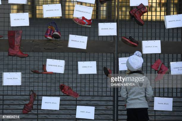 A picture taken on November 25 2017 near the courthouse of Nantes shows redpainted shoes symbolizing women victims of domestic violence harassment...