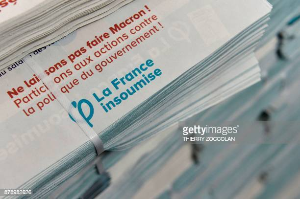 A picture taken on November 25 2017 shows leaflets during the Convention Nationale des Insoumis French leftist La France Insoumise in Cournon...