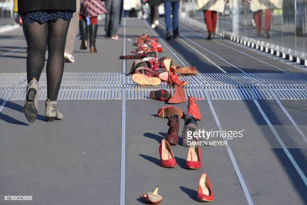 A picture taken on November 25 2017 shows redpainted shoes symbolizing all the women victims of domestic violence harassment rape sexual assault or...