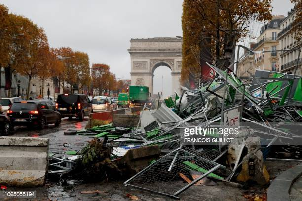TOPSHOT A picture taken on November 25 2018 near the Arc de Triomphe on the ChampsElysees avenue in Paris shows broken barriers a day after a rally...