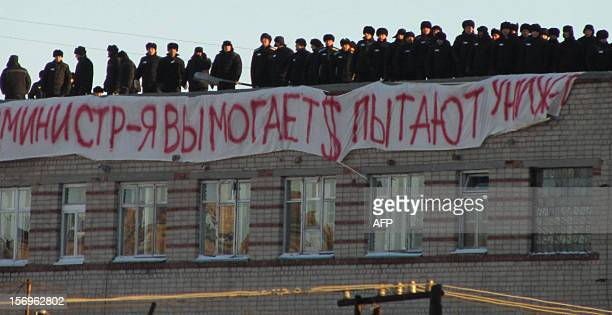 A picture taken on November 25 shows a group of inmates standing on a roof of the Prison Number 6 in Kopeisk in the Chelyabinsk region during their...