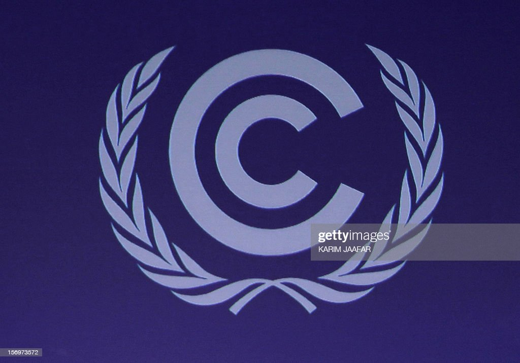 A picture taken on November 26, 2012 shows the logo of the 18th United Nations Convention on Climate Change in Doha. Nearly 200 world nations launched today a new round of talks to review commitments to cutting climate-altering greenhouse gas emissions. The two-week conference comes amid a welter of reports warning that extreme weather events like superstorm Sandy may become commonplace if mitigation efforts fail.
