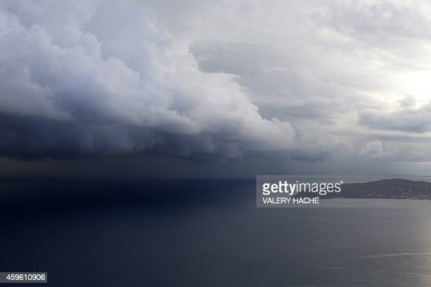 Picture taken on November 26, 2014 in Saint Jean Cap ferrat southeastern France, shows rain clouds above the sea. AFP PHOTO / VALERY HACHE