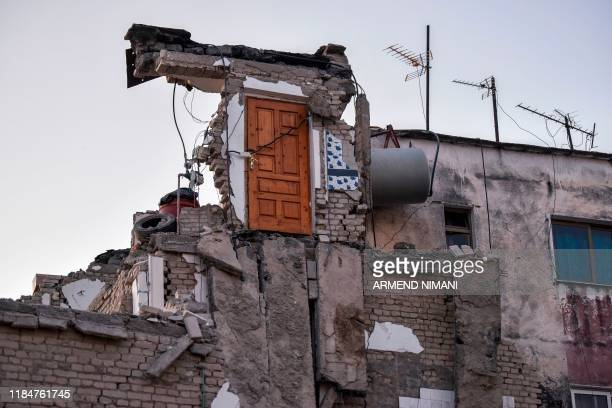 TOPSHOT A picture taken on November 26 2019 shows a collapsed building in Thumane northwest of capital Tirana after an earthquake hit Albania...