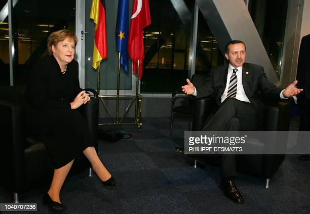Picture taken on November 27 2005 shows German Chancellor Angela Merkel talking with then Turkish Prime Minister Recep Tayyip Erdogan during a...