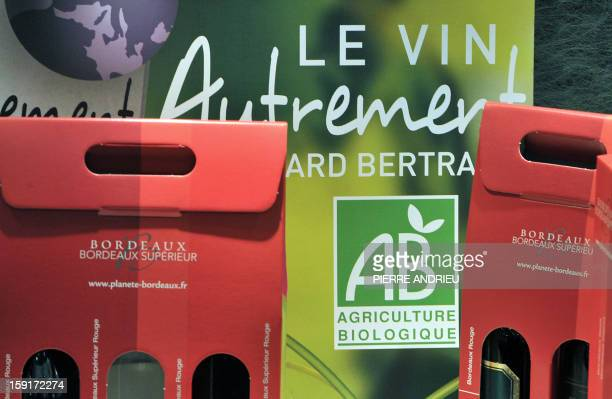 A picture taken on November 27 2012 shows the logo of the 'AB' French certified label next to wine boxes of a French organic wine producer at the...