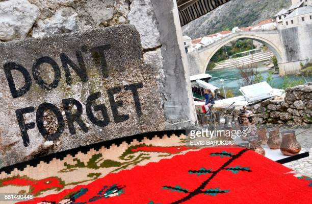 TOPSHOT A picture taken on November 27 2017 in the historical core of the southern Bosnian town of Mostar shows a writing near the Old Bridge A...