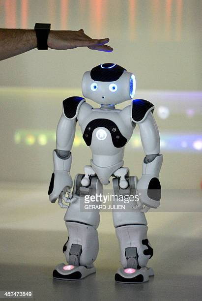 """Picture taken on November 28, 2013 shows """"NAO"""" a programmable humanoid robot developed by French robotics company Aldebaran Robotics at """"The Robot..."""
