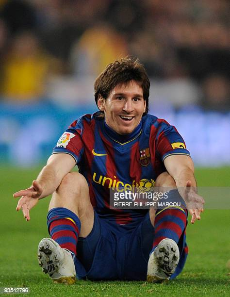 A picture taken on November 29 2009 shows Barcelona's Argentinian forward Lionel Messi gesturing as they play against Real Madrid during their...