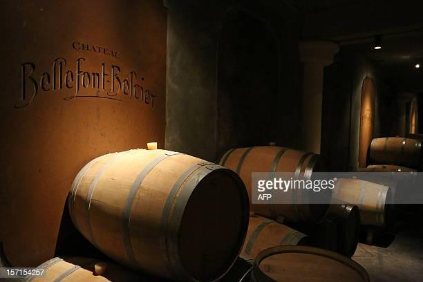 A picture taken on November 29 2012 shows barrels of wine in the cellar of Chateau Bellefont Belcier a SaintEmilion premier grand cru classe in the...