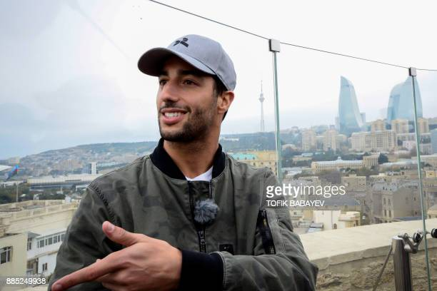 A picture taken on November 29 2017 shows Red Bull's Australian driver Daniel Ricciardo touring the Old city in Baku / AFP PHOTO / Tofik BABAYEV