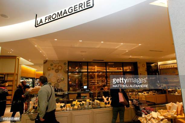 A picture taken on November 3 2015 shows customers being served at the cheese delicatessen in Le Bon Marche department store in Paris founded in 1852...
