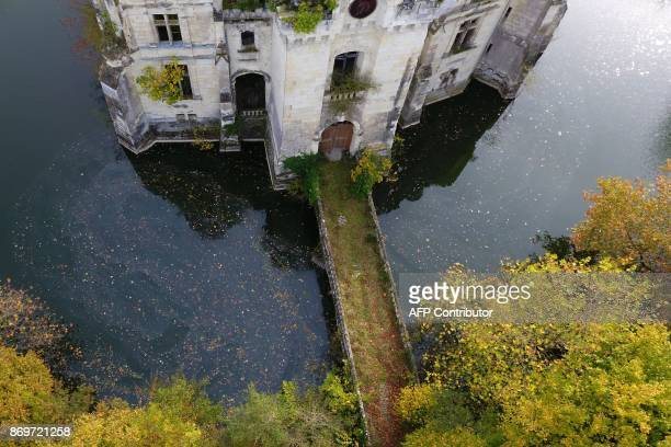 A picture taken on November 3 2017 shows an aerial view of the ruined castle of La MotheChandeniers in Les TroisMoutiers central western France...