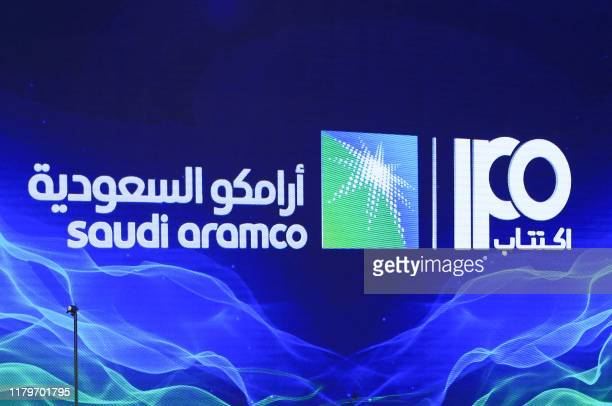 A picture taken on November 3 2019 shows a sign of Saudi Aramco's initial public offering during a press conference by the state company in the...