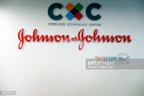 Picture taken on November 30, 2017 shows the logo of US multinational medical devices and pharmaceutical company Johnson & Johnson at the entrance of...