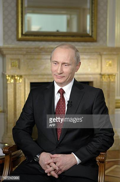 A picture taken on November 30 and made available by RIA Novosti on December 2 shows Russian Prime Minister Vladimir Putin during an interview...