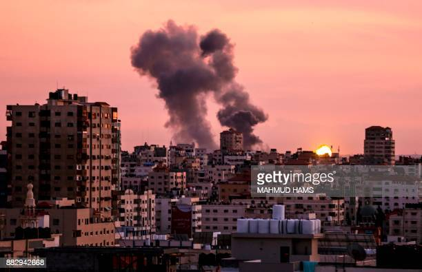 A picture taken on November 30 shows smoke billowing in Gaza City after Israel's military targeted Hamas posts in Gaza in retaliation to mortar...
