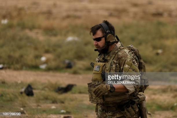 A picture taken on November 4 2018 shows a US soldier in the Kurdishheld town of AlDarbasiyah in northeastern Syria bordering Turkey Three armoured...
