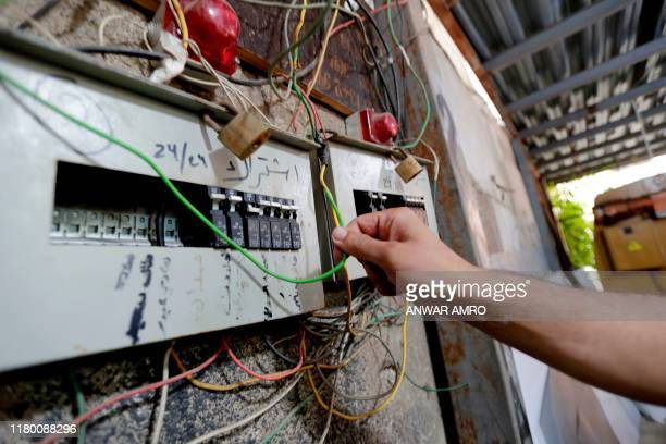 A picture taken on November 4 shows a circuit breaker of electric generator supplying homes with electricity in the Lebanese capital Beirut's...