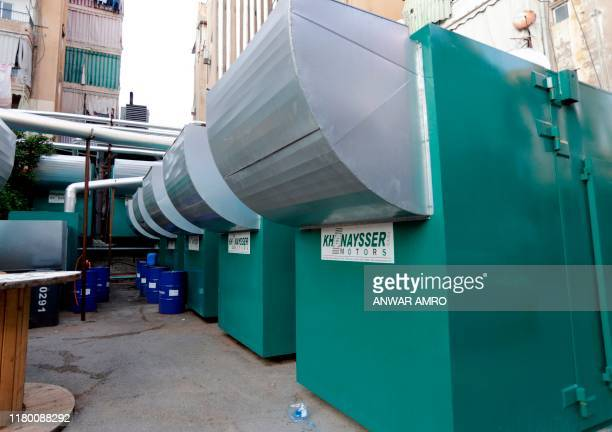 A picture taken on November 4 shows electric generators supplying homes with electricity in the Lebanese capital Beirut's southern suburbs An...