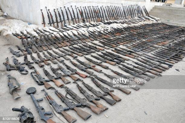 A picture taken on November 5 shows weapons reportedly seized by Syrian government forces during a military operation against Islamic State group...