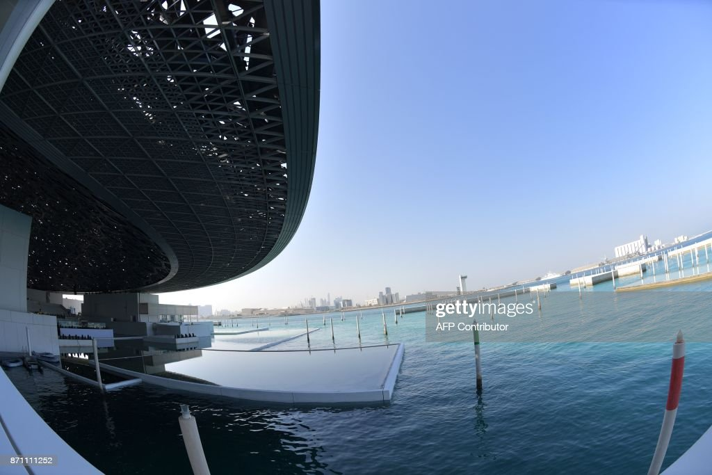 A picture taken on November 6, 2017 shows part of the Louvre Abu Dhabi Museum designed by French architect Jean Nouvel during a media tour prior to the official opening of the museum on Saadiyat island in the Emirati capital on November 8. More than a decade in the making, the Louvre Abu Dhabi opens its doors this week, bringing the famed name to the Arab world for the first time. The museum currently has some 300 pieces on loan, including an 1887 self-portrait by Vincent van Gogh and Leonardo da Vinci's 'La Belle Ferronniere'. /