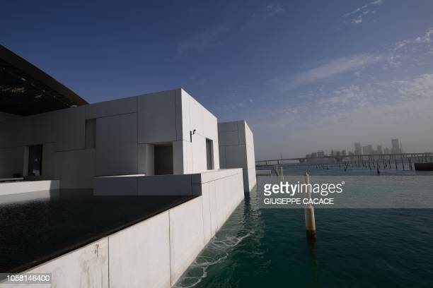 A picture taken on November 6 2018 shows a partial view of the Louvre Abu Dhabi museum in the Emirati capital The museum designed by the French...