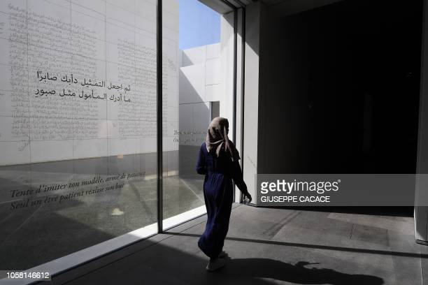 Picture taken on November 6, 2018 shows visitors inside the Louvre Abu Dhabi museum, in the Emirati capital. - The museum, designed by the French...