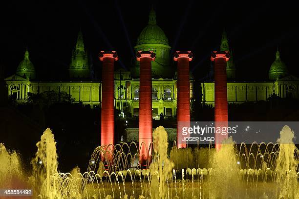A picture taken on November 7 2014 shows the National museum of Catalonia illuminated with the colours of the Catalan flag during the final meeting...