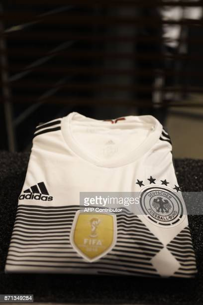 A picture taken on November 7 2017 in Berlin shows a jersey displayed during the official presentation of German national football team's new kit for...