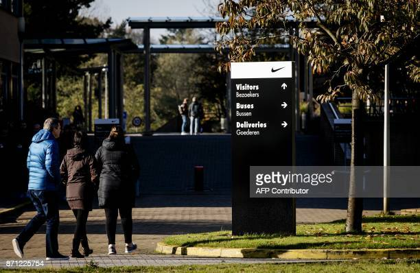 A picture taken on November 7 2017 shows people arriving at the headquarters of Nike Europe in Hilversum US sportswear giant Nike used a loophole in...