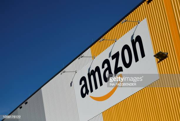 A picture taken on November 8 shows the logo of US online retail giant Amazon displayed outside the group's distribution center in Dortmund Germany /...