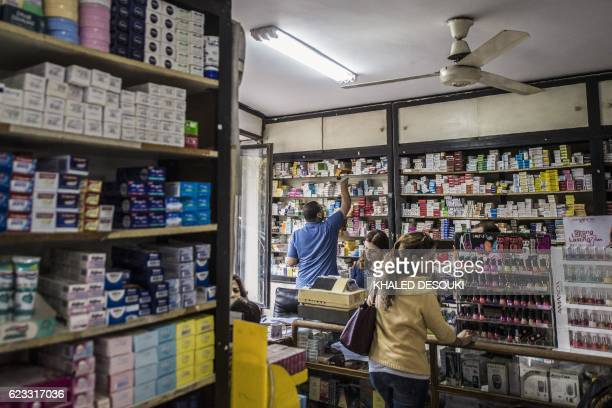 A picture taken on November 9 2016 shows a general view of a pharmacy in the Egyptian capital Cairo President Abdel Fattah alSisi and the central...