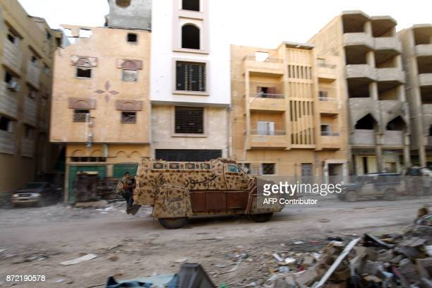 A picture taken on November 9 2017 shows a member of the selfstyled Libyan National Army loyal to the country's east strongman Khalifa Haftar riding...