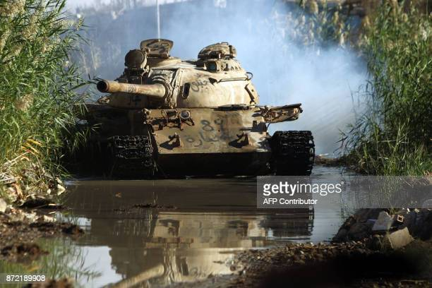 A picture taken on November 9 2017 shows a tank of the selfstyled Libyan National Army loyal to the country's east strongman Khalifa Haftar advancing...
