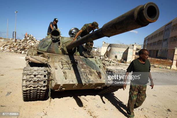 A picture taken on November 9 2017 shows members of the selfstyled Libyan National Army loyal to the country's east strongman Khalifa Haftar riding...