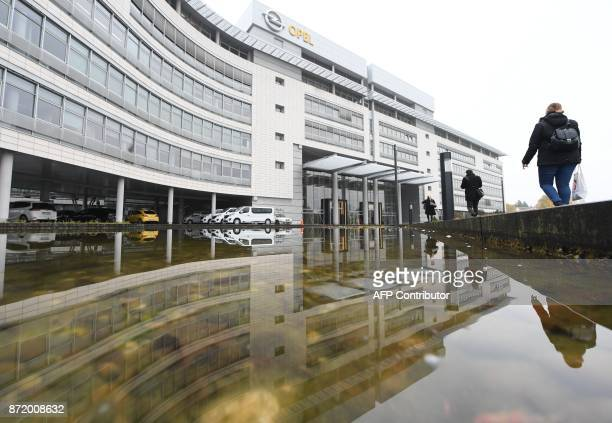 A picture taken on November 9 2017 shows the headquarters of car maker Opel in Ruesselsheim Germany French car maker PSA which also owns Peugeot and...