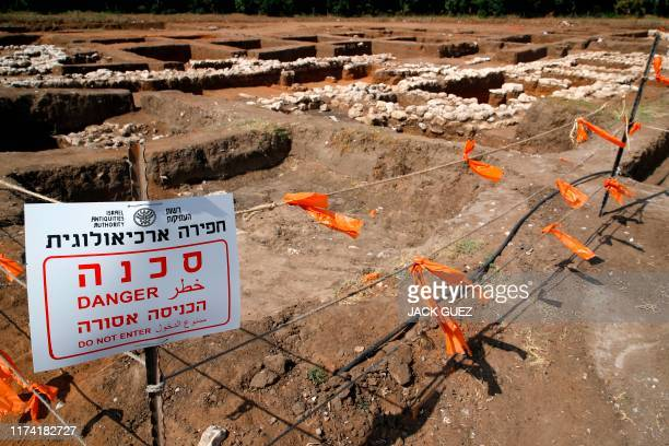 A picture taken on October 06 shows a warning sign and safety cordons at the archaeological site of En Esur where a 5000yearold city was uncovered...