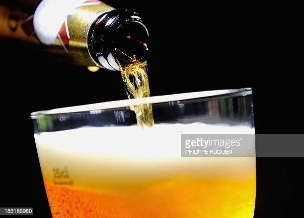 A picture taken on October 1 2012 shows beer poured from a bottle into a glass of beer in Lille northern France The level of taxation of beer will...