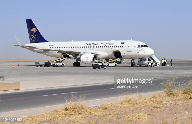 A picture taken on October 1 2018 shows a Saudi Airlines passenger plane after landing in Arbil airport in northern Iraq in the first direct flight...