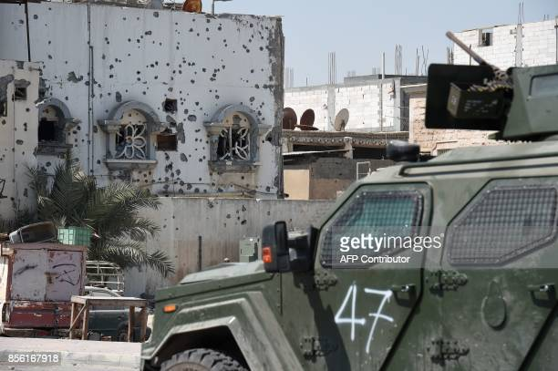 A picture taken on October 1 during a tour guided by Saudi authorities shows a troops vehicle in the Shiitemajority town of Awamiya in the eastern...